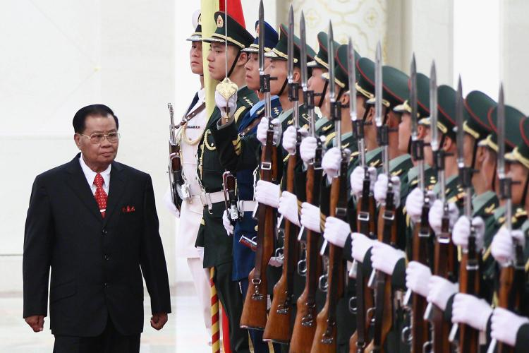 STRONG BACKING: Burmese military junta leader Gen. Than Shwe reviews a Chinese honor guard during a welcoming ceremony in Beijing, China, last September. Than Shwe retired as head of the Burmese military earlier this month, but many believe he still maintains a grip on power inside the isolated country. (Feng Li/Getty Images)