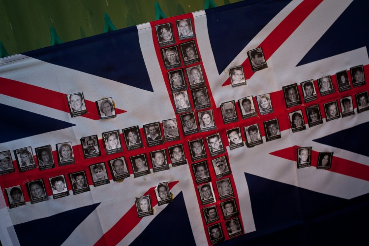 An Australian flag made up of photographs of victims of the 2002 bomb blast is seen on a fence at the site of the Sari Club in Jalan Legian, Bali, on Oct. 10, 2012. Many relatives and foreign tourists have begun to arrive to take part in ceremonies marking the 10th anniversary of the bomb attack in the Kuta tourist district. (Chris McGrath/Getty Images)