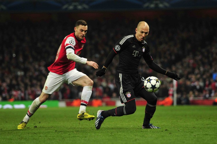 Bayern Munich winger Arjen Robben evades Arsenal defender Thomas Vermaelen at the Emirates Stadium in London, England in Champions League action on Feb. 19. (Glyn Kirk/AFP/Getty Images)