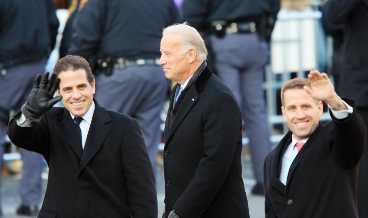 Vice-President Joe Biden and sons Hunter Biden (L) and Beau Biden walk in the Inaugural Parade in Washington, D.C. Beau Biden, Delaware's attorney general, was hit by a sudden stroke Tuesday.  (David McNew/Getty Images)