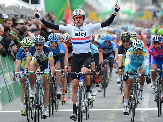 Sky's Bradley Wiggins (C) wins the Stage One sprint to claim the leader's jersey. (teamsky.com)