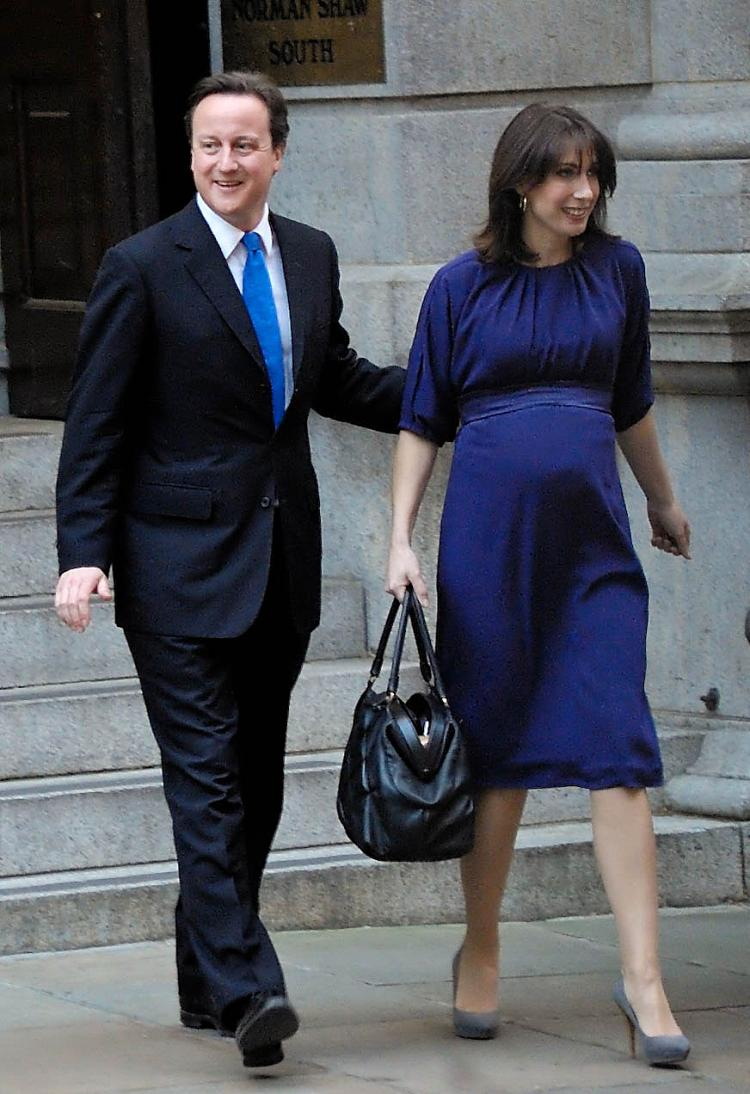 David Cameron heads out of Conservative Party headquarters with his pregnant wife Samantha on his way to visit the queen at Buckingham Palace. (Edward Stephen/Epoch Times)
