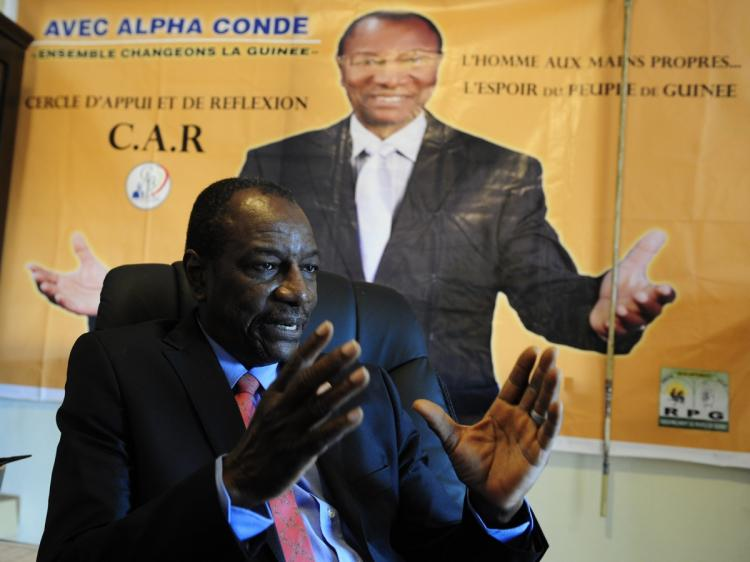 VOTE ON HOLD: Alpha Conde, Guinean presidential candidate for the Rally of the Guinean People Party, is photographed on Sept. 16 at party headquarters in Conakry, Guinea. (Issouf Sanogo/AFP/Getty Images)
