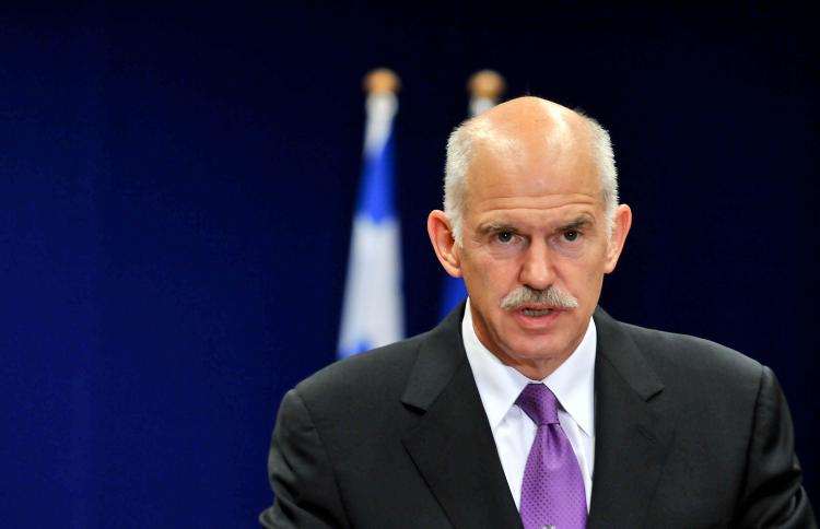 TIME TO SUE: Greek Prime Minister George A. Papandreou gives a press conference at the  European Union summit at the European Council headquarters on May 7 in Brussels. Papandreou announced Greece might sue the U.S. banks.  (Georges Gobet/AFP/Getty Images )