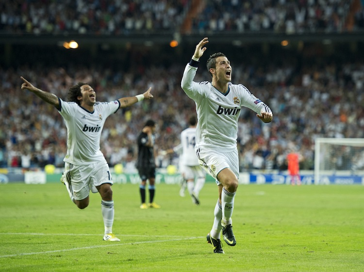 Real Madrid's Cristiano Ronaldo (R) celebrates his game-winning goal against Manchester City in Champions League play in Madrid on Tuesday, September 18, 2012. (Jasper Juinen/Getty Images)