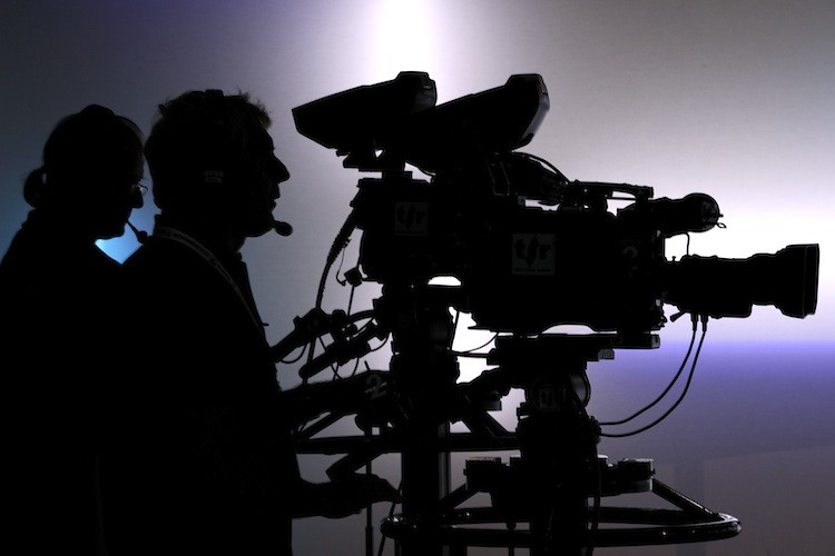 Television cameramen film in a broadcast studio in this file photo. A recent Gallup poll found that more than half of Americans surveyed do not trust the media. (Fabrice Coffrini/Getty Images)