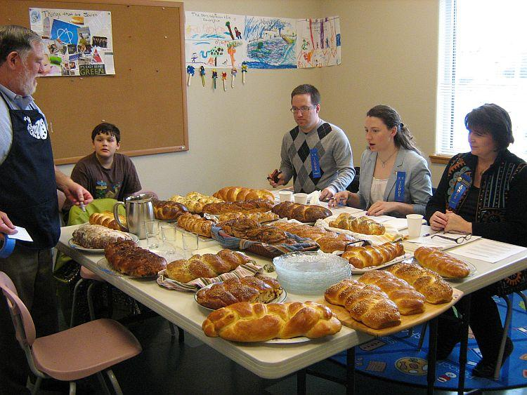LOVELY LOAVES: Judges choose the best challah. (Lisa Wederspahn/The Epoch Times)