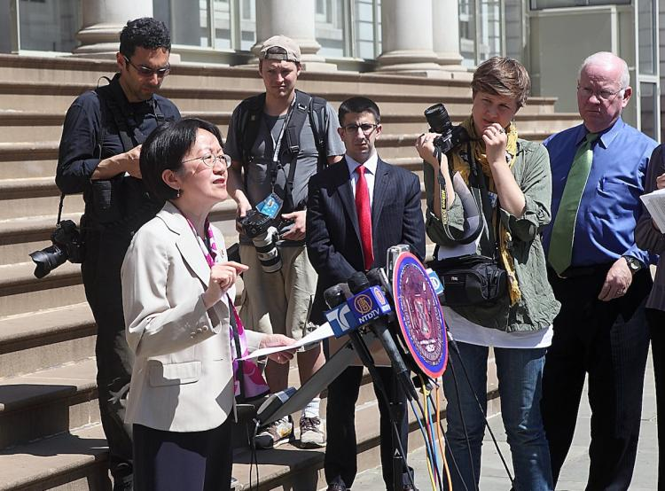 HANDBAGS TO HANDCUFFS: Councilwoman Margaret Chin proposes legislation to crackdown on people buying counterfeit goods.   (Gary Du/The Epoch Times )