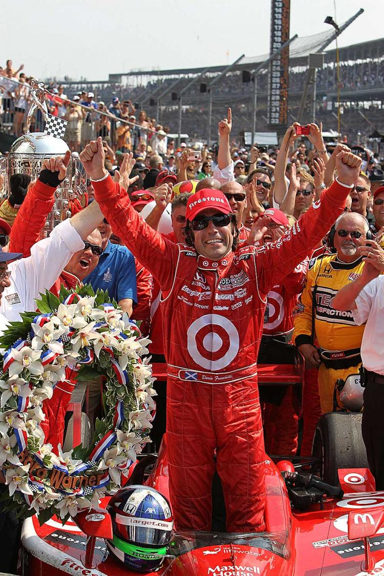Dario Franchitti celebrates in victory lane after winning the IZOD IndyCar Series 94th running of the Indianapolis 500. (Nick Laham/Getty Images)