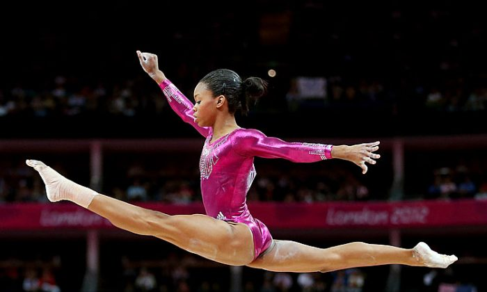 Gabrielle Douglas of the United States soars above the balance beam during the Artistic Gymnastics Women's Individual All-Around final on Day 6 of the London 2012 Olympic Games. (Streeter Lecka/Getty Images)