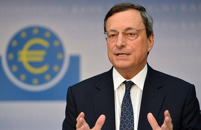 Mario Draghi, president of the European Central Bank (ECB), addresses the media following a meeting with the ECB's council in Frankfurt, on Sept. 6. The European Central Bank has applied the concept of negative interest rates to money banks hold at the Central Bank. (Johannes Eisele/AFP/Getty Images)