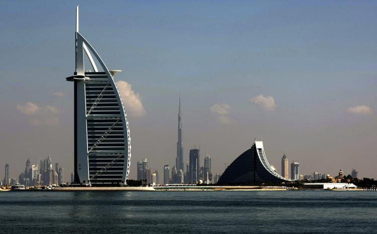 Dubai's three most prominent architectural icons, Burj an-Arab Hotel (L), Jumirah Hotel (R) and Burj Dubai (C), are seen along the coast of Dubai.  (Marwan Naamani/Getty Images )