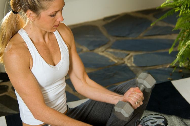 Total-body strength training prior to cycling burns more fat. (Photos.com)