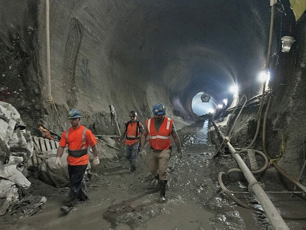 Workers walk through the East Side Access under Grand Central Station