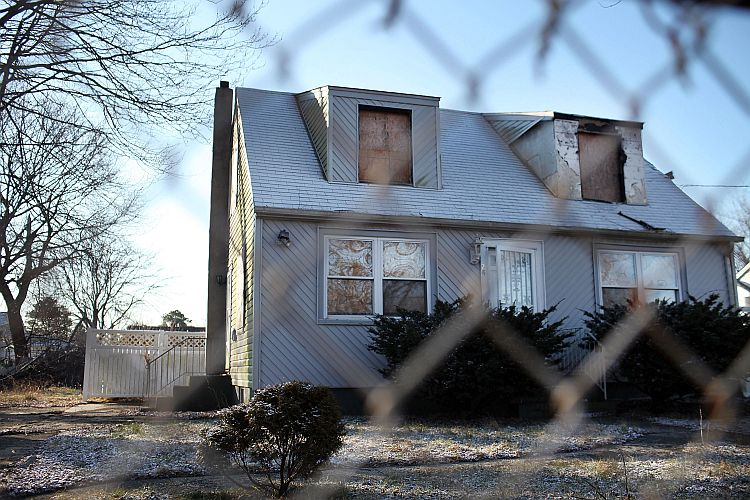 A foreclosed home stands boarded up on Feb. 9 in Islip, NY