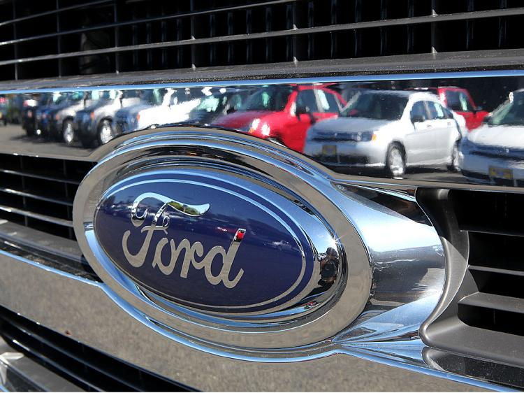 Despite better-than-expected quarterly earnings, Ford�¢ï¿½ï¿½s stock slipped 56 cents. (Justin Sullivan/Getty Images)