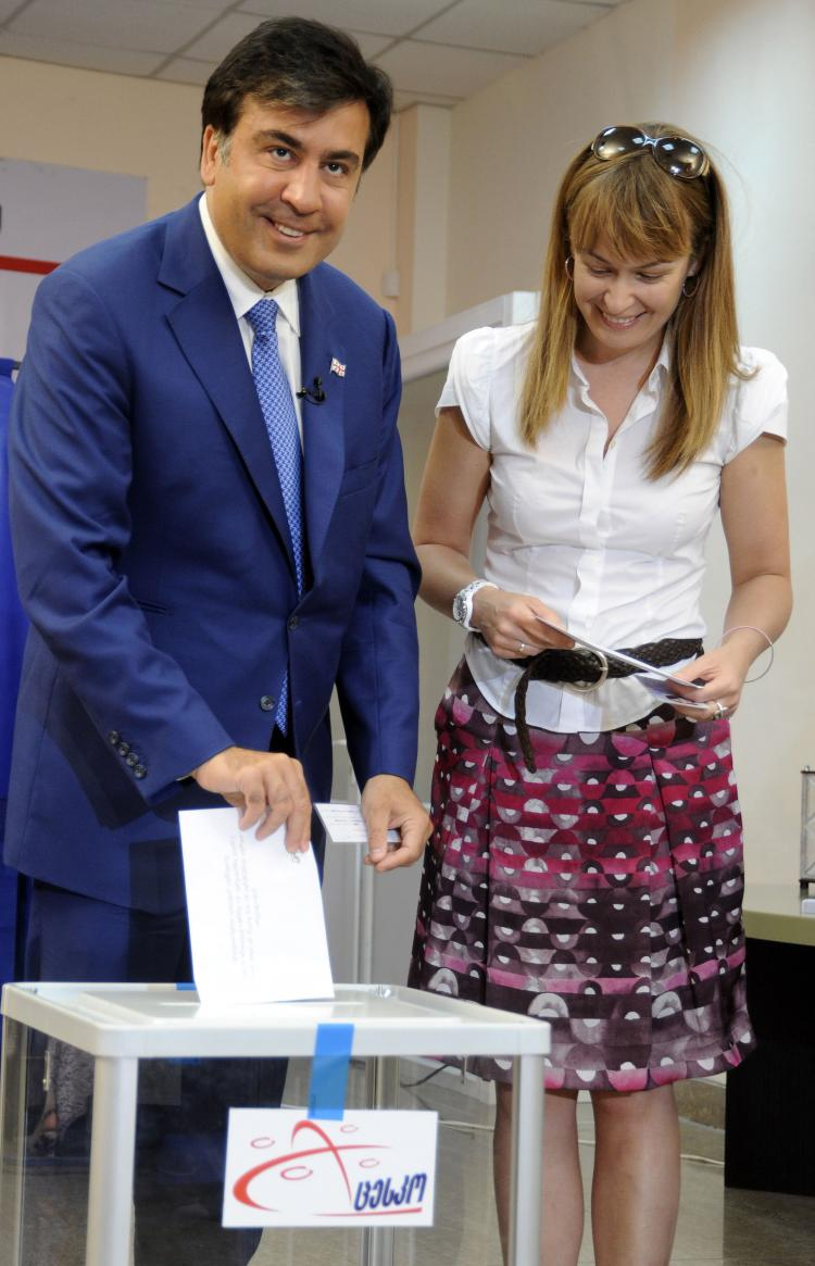 Georgian President Mikheil Saakashvili and his wife Sandra Roelofs vote in Tbilisi on May 30. Georgians voted in nationwide municipal elections seen as a key test of pro-Western President Mikheil Saakashvili's commitment to democratic reform. (Irakli Gedenidze/Getty Images)