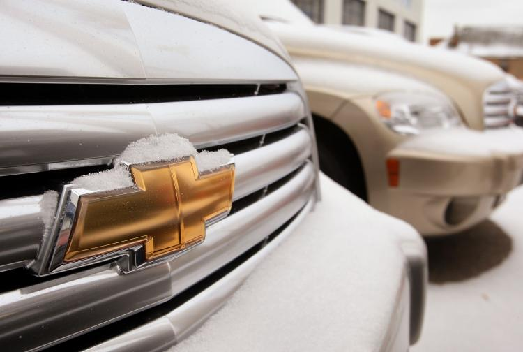 Chevrolet vehicles sit on the lot of a car dealership in Chicago, Illinois.  (Scott Olson/Getty Images)