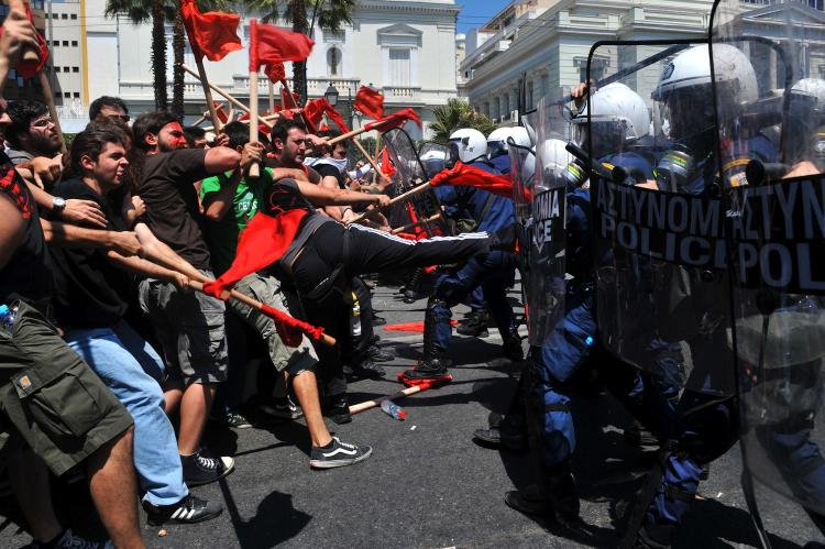Demonstrators clash with police outside the Greek Parliament during a massive May Day demonstration to protest the austerity measures on May 1. (Louisa Gouliamaki/AFP/Getty Images)