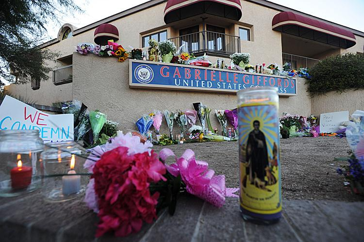 Gabrielle Giffords Alive: People leave flowers and candles outside the Tucson office of U.S. Rep. Gabrielle Giffords (D-AZ), who was shot during an event in front of a Safeway grocery store January 8, 2011 in Tuscon, Arizona. (Laura Segall/Getty Images)