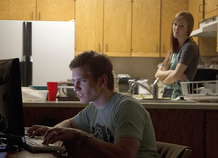 Actors pose for a photograph illustrating marriage problems caused by playing online role-playing game