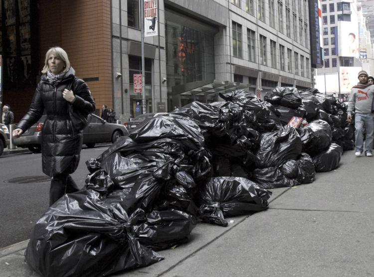 PILED UP: The Department of Sanitation will resume trash pickup in New York City on Monday. Collection was suspended due to the snowstorm that hit the city on Dec. 26.  (Phoebe Zheng/The Epoch Times)