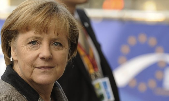 German Chancellor Angela Merkel arrives at the EU Headquarters for a European People's Party (EPP) enlarged summit in Brussels on Dec. 13, 2012. Germany's leading role in handling Europe's debt crisis will give a wider importance to the country's federal elections in 2013. (John Thys/AFP/Getty Images)