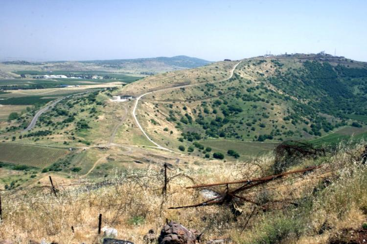 A view of the Golan near the cease-fire line with Syria, with a mine field in the foreground. (Genevieve Long/The Epoch Times)