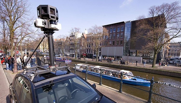 A Google Street View camera fastened on top of a car in Amsterdam