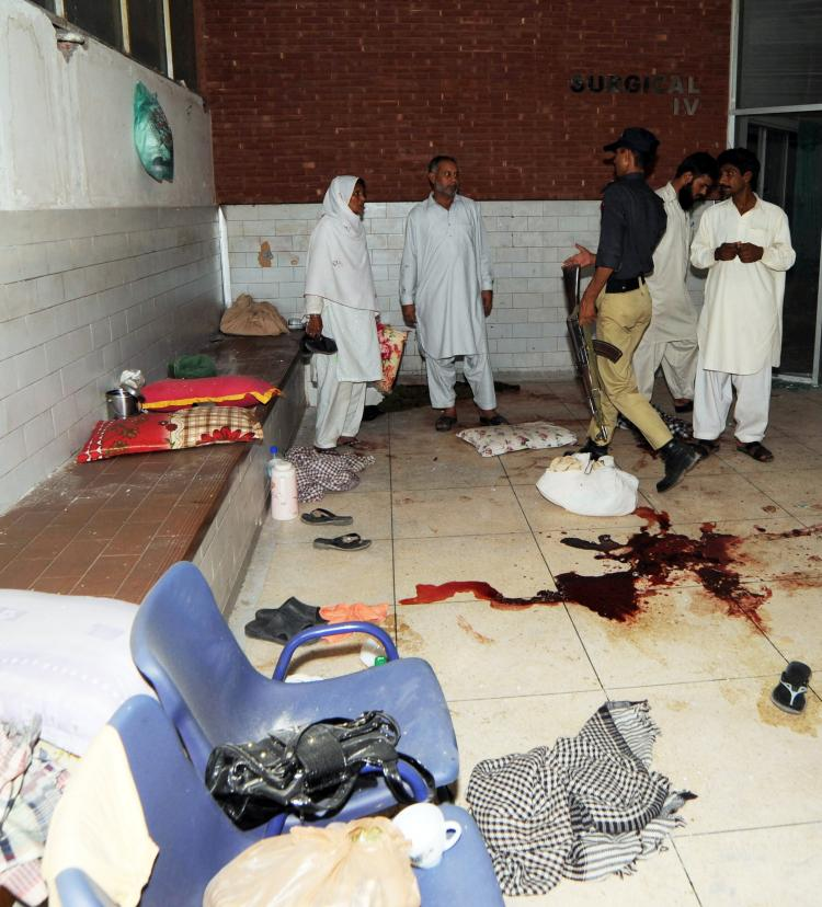 A Pakistani policeman examines the room of a hospital room following the gunmen attack at the Jinnah Hospital in Lahore on May 31. The Gunmen opened fire at a Pakistan hospital where victims of attacks on Ahmadi mosques were being treated killing 12. (Arif Ali/AFP/Getty Images)