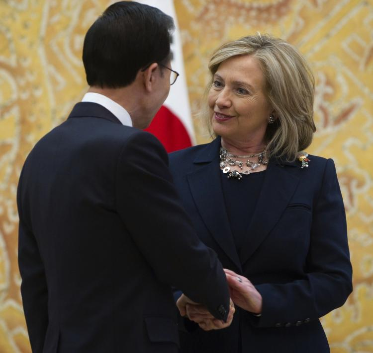 CLOSE TO A DEAL: South Korean President Lee Myung-bak shakes hands with Secretary of State Hillary Clinton during their meeting at the Presidential Blue House in Seoul on April 17. Clinton told South Korean officials that a long delayed free trade deal was almost sealed. (Saul Loeb/Getty Images )