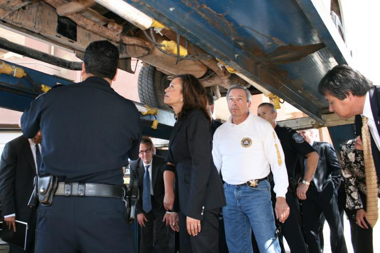 Attorney General Kamala D. Harris inspects a car used to smuggle drugs at the Calexico port of entry. (Courtesy of Calif. Attorney General's Office)