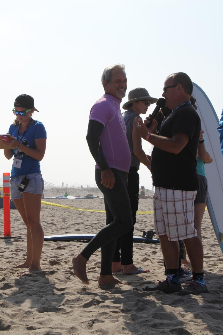 Gregory Harrison (L), TV and movie celebrity, is interviewed by PT Townend (R), a surfing legend, recalling the highlights of the day.  (Danielle Kaiser)