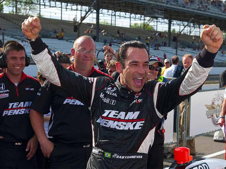 Helio Castroneves celebrates after earning pole position during Pole Day qualifying for the IZOD IndyCar Series 94th running of the Indianapolis 500. (Robert Laberge/Getty Images)