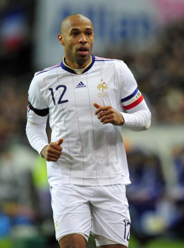France's attacker Thierry Henry runs during a friendly international football match against Spain at the Stade de France in Paris on March 3. (Franck Fife/AFP/Getty Images )