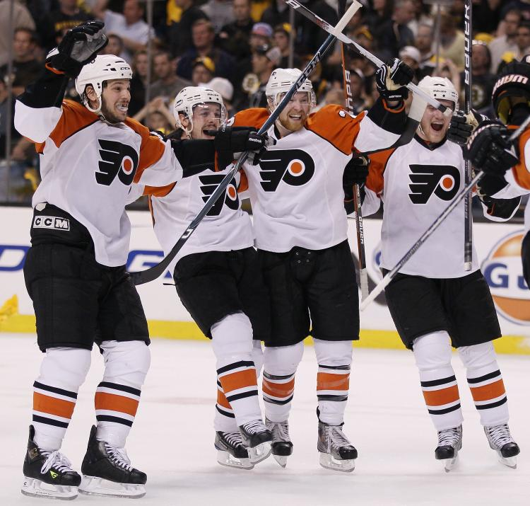 ORANGE CRUSH: The Philadelphia Flyers' victory over the Boston Bruins after losing the first three games of the series is one of the reasons hockey playoffs have been trumping basketball playoffs this year. (Elsa/Getty Images)