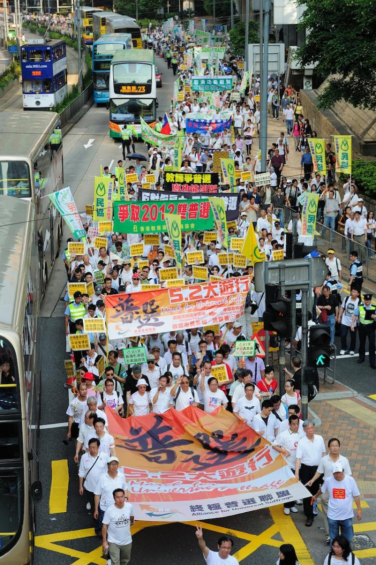 Over 1000 protesters marched for freedom in Hong Kong on Sunday, as public discontent is brewing over Mainland's restriction on democratic governance.  (Win Hanlin/The Epoch Times)