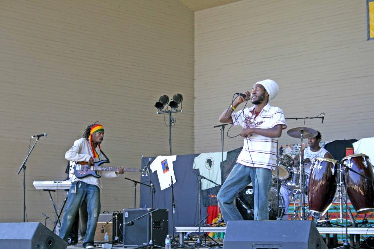Israel, lead singer of Jamaican Reggae group Maximum Force, performs at Afrikadey! on Saturday. (Neil Campbell/The Epoch Times)