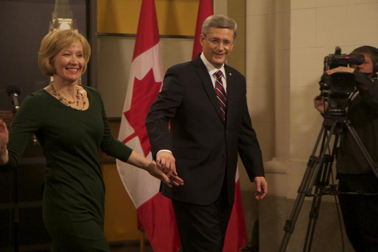 Stephen Harper and his wife Laureen leave the Government Convention Centre after the leader's debate on on Tuesday evening. (Matthew Little/The Epoch Times)