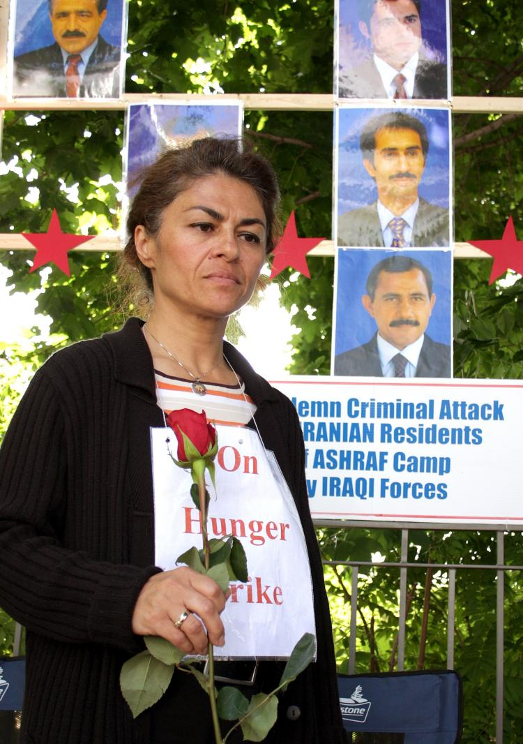 Vahideh Korram-Roudi commemorating the Iranians killed by Iraqi forces in Camp Ashraf during the early days of her hunger strike in front of the U.S. Embassy in Ottawa this summer (Samira Bouaou)