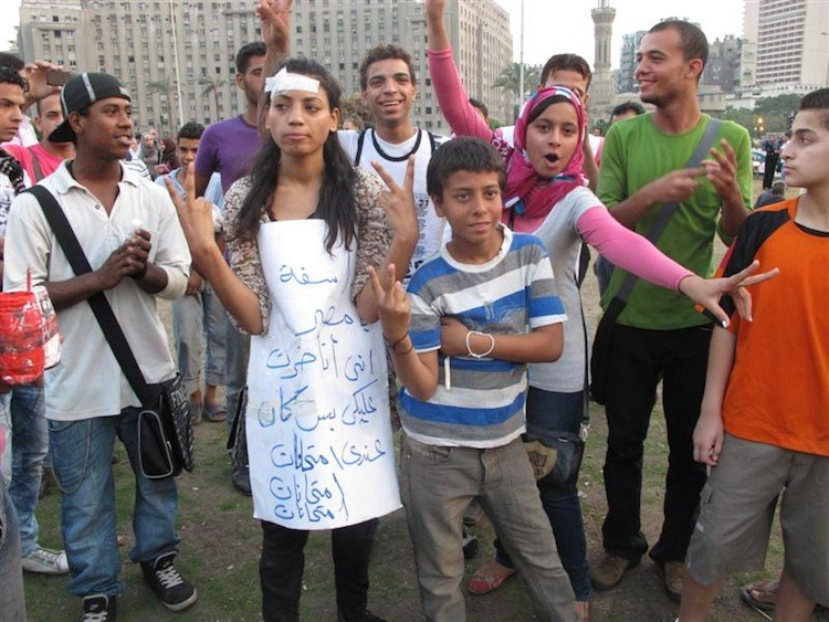 The sign reads: 'Egypt, I am sorry that I could not come [to demonstrate]. I had an exam.' (Yaira Yasmin/The Epoch Times)