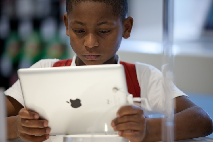 A boy looks at an iPad at the an Apple retail store. A recent report by the Global Information Industry Center warns that due to the increasing demands placed on the U.S.'s wireless infrastructure, demand will outstrip capacity unless steps are taken to provide more bandwidth for future generations. (Yasuyoshi Chiba/Getty Images)