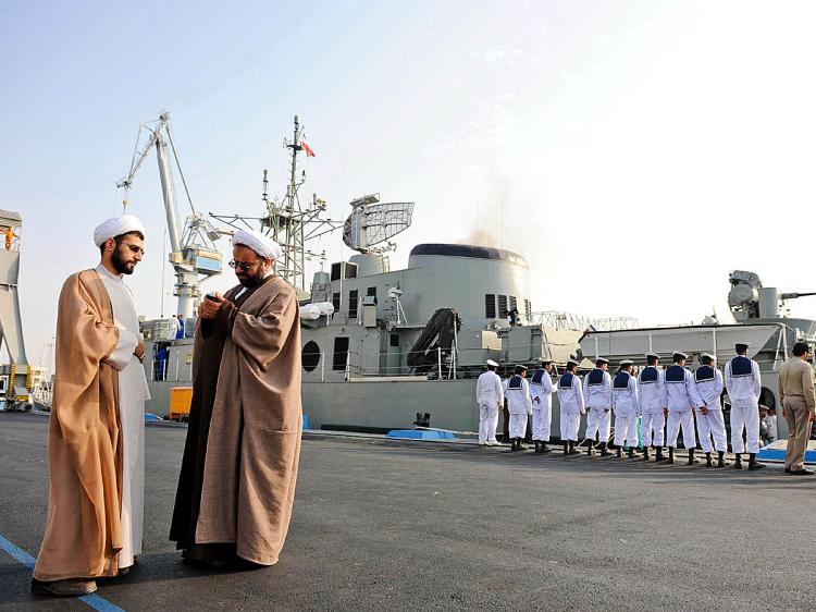 GULF TENSIONS: Iranian clerics stand in front of an Iranian warship during naval maneuvers in the Persian Gulf on Feb. 21, 2009. (Ebrahim Nourozi/AFP/Getty Images)