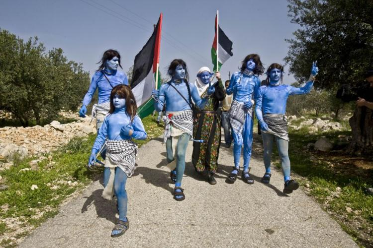 Villagers of Bil'in together with Israeli and international activists dressed like the Na'vi characters from the movie 'Avatar', take part in the weekly demonstration against a security fence built by Israel near the village of Bilin on Feb. 12.  (Oren Ziv/AFP/Getty Images )