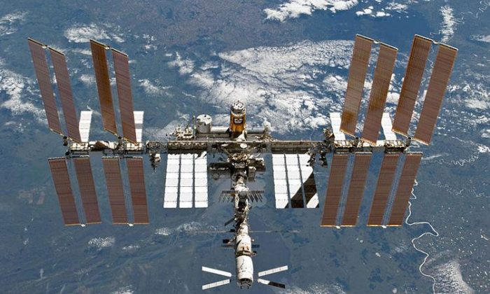 """The International Space Station on Mar. 7, 2011. Thousands of pieces of """"space junk"""" orbiting the Earth pose a danger to satellites and even the International Space Station. (NASA)"""