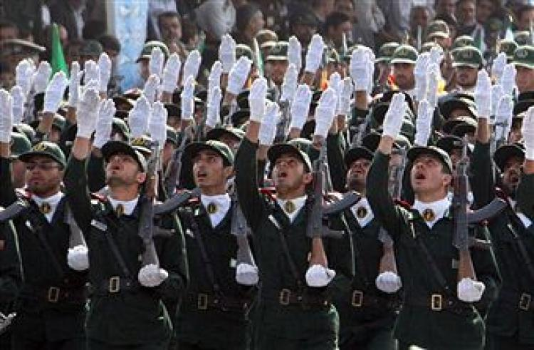 Iran's elite Revolutionary Guards march during an annual military parade which marks Iran's eight-year war with Iraq, in the capital Tehran on September 22, 2009. (ATTA KENARE/AFP/Getty Images)
