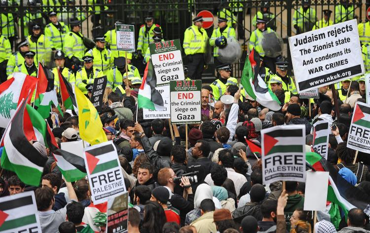 Protesters demonstrate outside the Israeli Embassy in London on May 31, when more than 10 people were killed by Israeli commandos when they stormed a ship which was part of a gaza flotilla of six ships carrying 1,000 tonnes of aid to the Gaza strip.  (Carl De Souza/Getty Images)