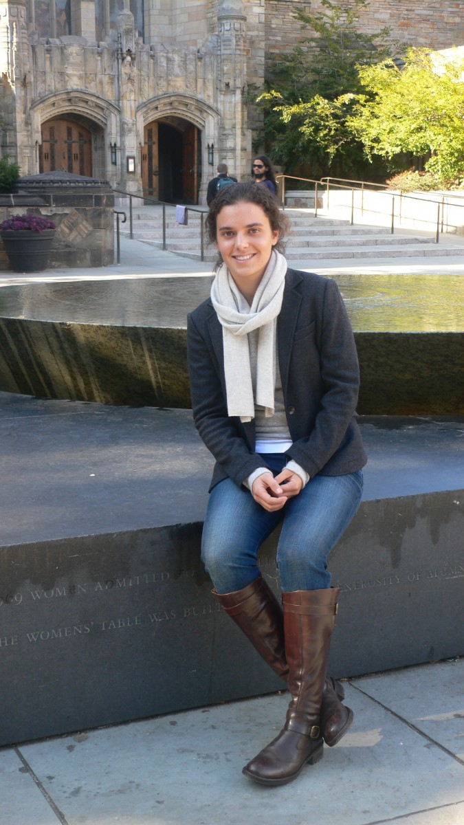 Jennifer M. Bright at Yale University in the Fall of 2010. Bright sits on The Women's Table by the artist Maya Lin in front of Sterling Memorial Library. (Joan H. Bright)