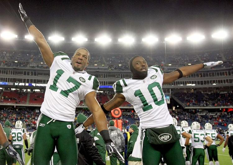 Braylon Edwards and Santonio Holmes celebrate a memorable upset victory over the top-seeded New England Patriots on Sunday. (Al Bello/Getty Images)