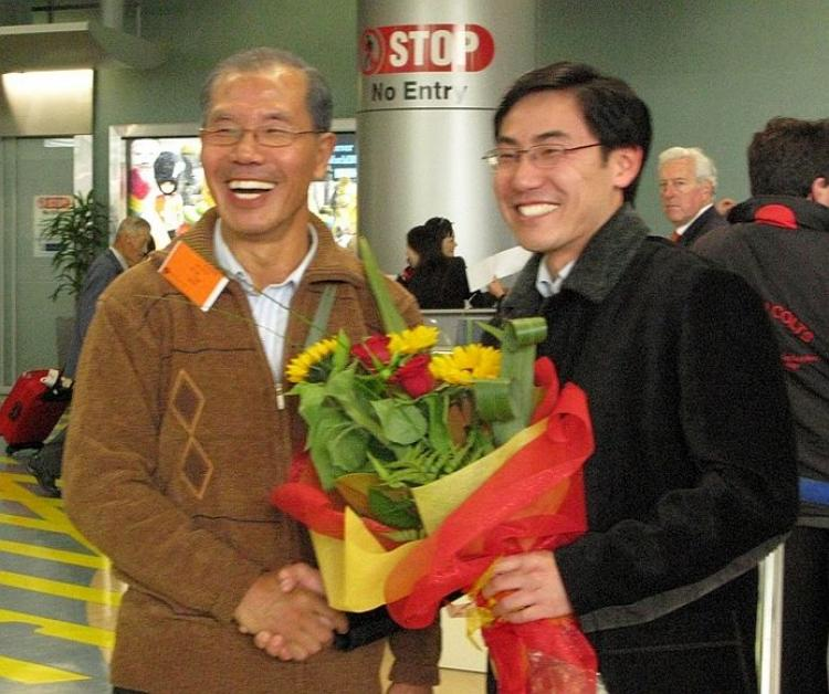 FATHER AND SON: Jia Jia (left) and his son Jia Juo at the New Zealand airport in 2007 when Jia Jia arrived after defecting from the Chinese Communist Party. (The Epoch Times)